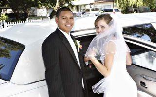 wedding bride groom getting into white limousine