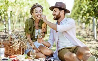 woman man couple having a picnic in the vineyard lodi wine tours vintage limousine